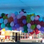 Balloons are filled with candy, tickets, & passes!